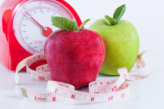Lose weight. Apple and weights with measuring tape royalty free stock photo