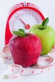 Lose weight. Apple and weights with measuring tape stock photos
