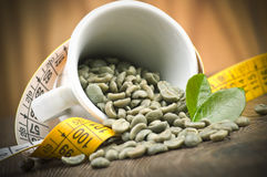 Lose weight by green coffee. Lose weight by drinking raw green coffee Royalty Free Stock Photography