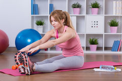 Lose weight at home. Young woman wants to lose weight at home Royalty Free Stock Image