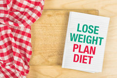 Lose Weight Plan Diet. Message in NoteBook on Kitchen Table Stock Photography