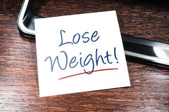 Lose Weight Reminder On Paper Lying On Wooden Cupboard Stock Photo