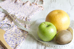 Lose weight to clothes concept with dress and fruits diet. Abstract royalty free stock photos