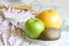 Lose weight to clothes concept with dress and fruits diet. Abstract stock photography