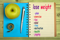 Lose weight words. On notebook Royalty Free Stock Photos