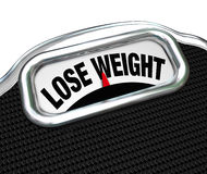 Lose Weight Words Scale Overweight Losing Fat. The words Lose Weight on the display of a scale to tell you you need to go on a diet to drop pounds and trim fat Stock Photos