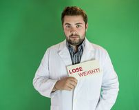 Lose weight. Young nutritionist with Lose Weight sign Stock Photo