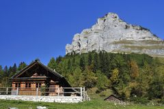 Loser & Alpine Cottage. The rock massif of Loser and an alpine cottage in Totesgebirge mountains - Austria Royalty Free Stock Photo