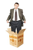 Loser appears out from the cardboard box and shows empty pockets Stock Photo