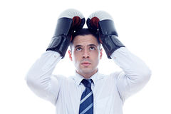 Loser businessman covers his head with boxing gloves Royalty Free Stock Photos