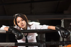 Loser businesswoman on boxing ring Royalty Free Stock Image