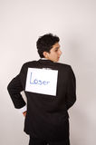 Loser - noticing the joke. Young male spotting a loser sign on his back royalty free stock images