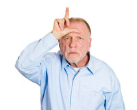 Loser sign, older man Royalty Free Stock Images
