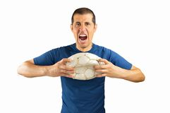 Loser soccer player. Loser angry and aggressive player football holding the damaged soccer football on white background with copy space for text or design Royalty Free Stock Photo