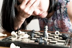 The loser women sad after  fighting the chess, committed, competition, winner, successful, dedicate concept. The loser woman sad after  fighting the chess Stock Photos