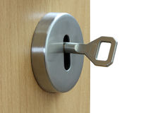 Loseup of an keyhole with key on a wooden  door. Royalty Free Stock Photo