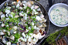 Сloseup of mushrooms and onions in pan and mixed with wooden sp. Oon Stock Photography