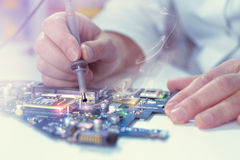 Цloseup on tester checking motherboard Royalty Free Stock Image