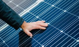 Free Loseup View, Man Hand Lay On Solar Panels Stock Image - 161873431