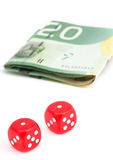 Losing dice roll with bills  Stock Photo