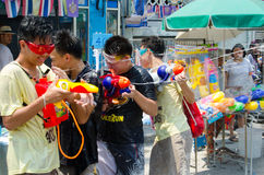 Losing the fight. Bangkok, Thailand, 14 April 2015. A group of teens losing a water gun battle at the Khao San Road Songkran Street Party. The annual Songkran Stock Photography