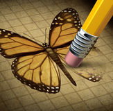 Losing Hope. And lost faith as a social concept of personal human despair with the symbol of a monarch butterfly being erased by a pencil as an icon of broken Stock Photo