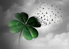 Losing Luck. Or spreading good fortune concept as a four leaf clover transforming into flying birds as a surreal communication metaphor for financial and life Stock Photo