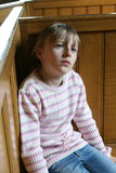 Losing my religion. A girl in church deep in thought Royalty Free Stock Photo