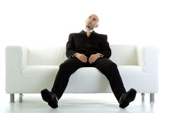 Losing patience. A young executive looks up, losing patience while he waits Royalty Free Stock Photos