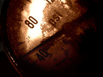 Losing pressure. Grungy shot of dirty air pressure gauge on broken machinery Stock Photography