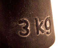 Losing Three Major Kilos. High contrast photo of a three kilogram object. The photo was taken to highlight the heavy weight Royalty Free Stock Images