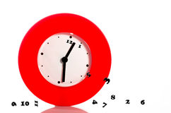 Losing time. Metaphor with numbers falling off a clock Stock Photography