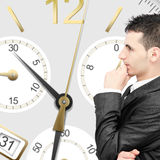 Losing time and money. Businessman thinking to much and losing time Royalty Free Stock Photos