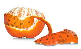 Losing Weight. Peel off the inches: A half-peeled tangerine with the skin/peel resembling a measuring tape (inches Royalty Free Stock Photography