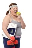 Losing weight with apple and dumbbells Stock Image