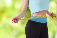 Losing weight. Concept of losing weight with sport Stock Photography