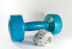 Losing weight. Exercice. Losing weight. Tape measure and dumbbell Stock Image