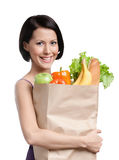 Losing weight program. Attractive girl with the packet of fruit and vegetables, Isolated, white background. Losing weight program Stock Photography