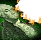 Losing Your Investment. And financial debt crisis concept with a paper currency icon of George Washington and flames burning the paper as a symbol of declining Royalty Free Stock Photos