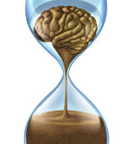 Losing your memory. Problems as a mental illness symbol of Dementia and Alzheimer disease with an hour glass and time icon of sand shaped as a human brain as Royalty Free Stock Photos