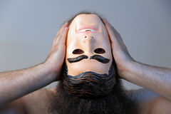 Losing Your Mind. A man is losing his mind and proceeds to rip his own head off Royalty Free Stock Photography
