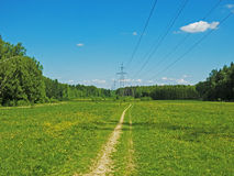 Losinyy Ostrov. A small road exiting the village Abramtzevo. Summer. A bright sunny day stock photography