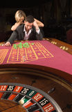 Loss. The man and woman have lost in a casino Royalty Free Stock Photo