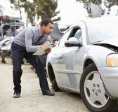 Loss Adjuster Inspecting Car Involved In Accident Stock Images