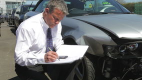 Loss Adjuster Inspecting Car Involved In Accident stock video
