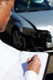 Loss Adjuster Inspecting Car Involved In Accident Royalty Free Stock Photo