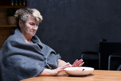 Loss of appetite. Depressed appetite- elderly woman refusing to eat meal Royalty Free Stock Image