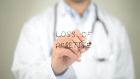 Loss of Appetite, Doctor writing on transparent screen. High quality Royalty Free Stock Images