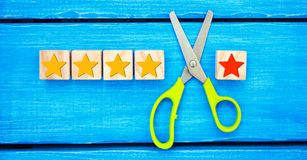 Loss of the fifth star. Unsuccessful business. Overview of hotel, cafe. deterioration of the rating and quality and status. a fals. E assessment.The critic stock image