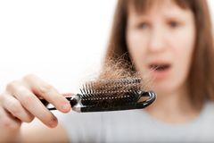 Loss hair comb in women hand Royalty Free Stock Photos